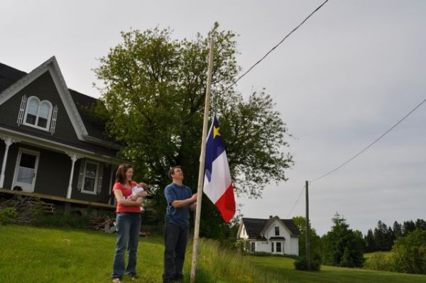Raising the Acadian Flag